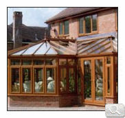 Mahogany effect P shaped conservatory
