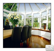 Inside of a victorian style white uPVC conservatory